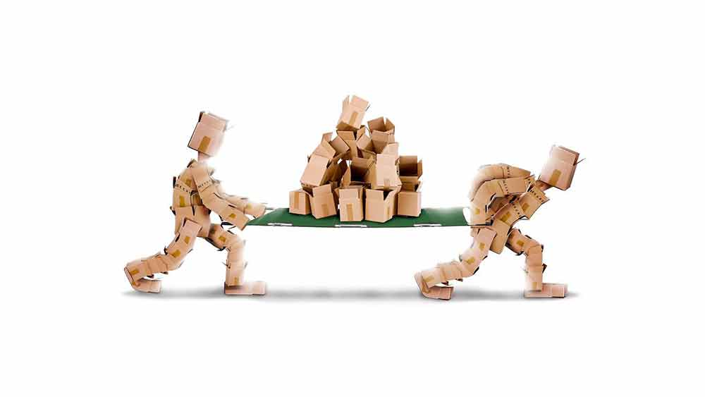 Cardboard Box Men Carrying A Pile Of Cardboard Boxes On A Green Stretcher